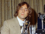 """FILE - In this 1971 file photo, singer John Lennon appears during a press conference. Lennon is featured in """"1971: The Year That Music Changed Everything,"""" an eight-part documentary series that premieres Friday on the Apple+ streaming service. (AP Photo, File)"""