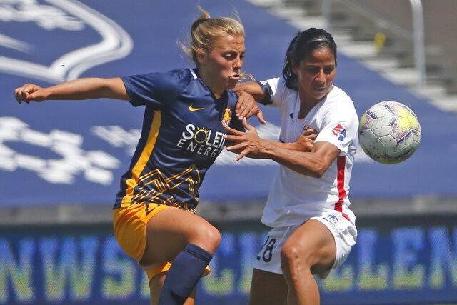 Utah Royals FC defender Madeline Nolf, left, battles with OL Reign midfielder Shirley Cruz, right, during the first half of an NWSL Challenge Cup soccer match at Zions Bank Stadium Wednesday, July 8, 2020, in Herriman, Utah. (AP Photo/Rick Bowmer)
