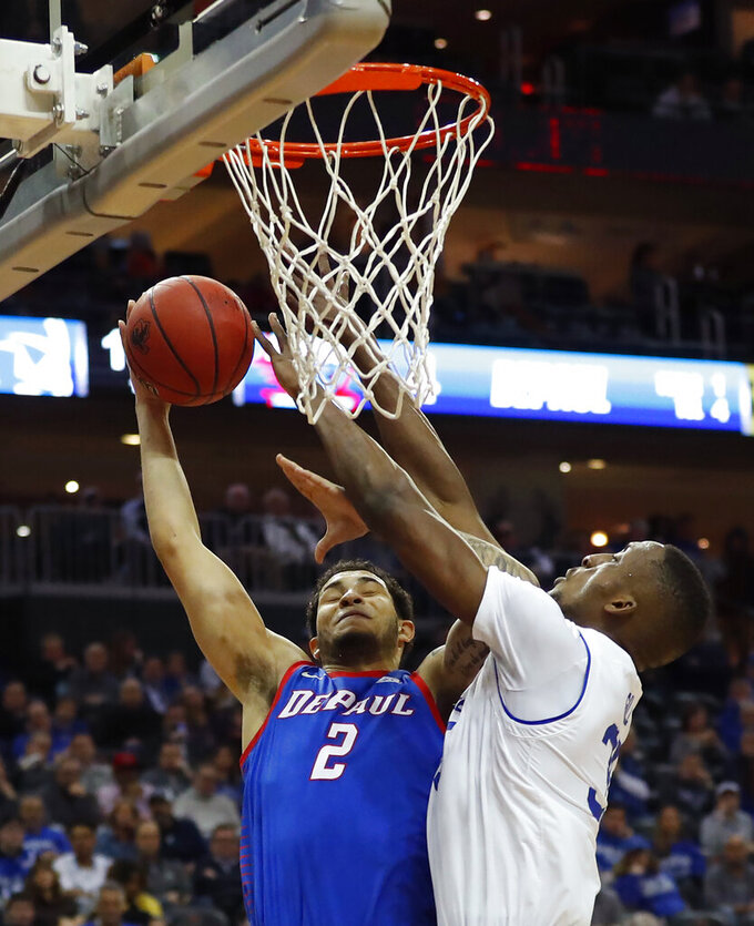 Seton Hall's Romaro Gill, right, defends against DePaul's Jaylen Butz (2) during the first half of an NCAA college basketball game Wednesday, Jan. 29, 2020 in Newark, N.J. (AP Photo/Noah K. Murray)