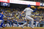 Toronto Blue Jays' Rowdy Tellez watches his solo home run next to Los Angeles Dodgers catcher Will Smith during the ninth inning of a baseball game Wednesday, Aug. 21, 2019, in Los Angeles. (AP Photo/Mark J. Terrill)
