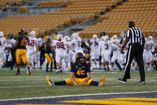 California's Slater Zellers sits on the field after Stanford blocked an extra-point kick during the second half of an NCAA college football game Friday, Nov. 27, 2020, in Berkeley, Calif. (AP Photo/Jed Jacobsohn)