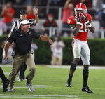 Georgia coach Kirby Smart celebrates after defensive back J.R. Reed, right, intercepted a pass from Notre Dame quarterback Ian Book during the fourth quarter of an NCAA college football game Saturday, Sept. 21, 2019, in Athens, Ga. (Curtis Compton/Atlanta Journal Constitution via AP)