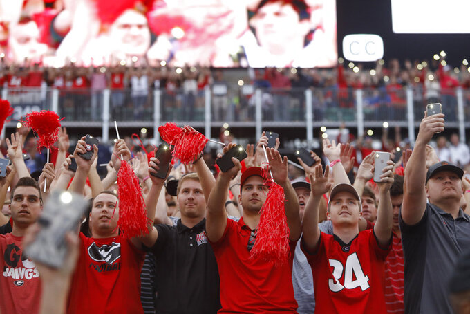 Georgia fans light up the crowed as the game goes into the fourth during the second half of an NCAA college football game between Georgia and Florida at in Jacksonville, Fla. Saturday, Oct. 27, 2018. (Joshua L. Jones/Athens Banner-Herald via AP)