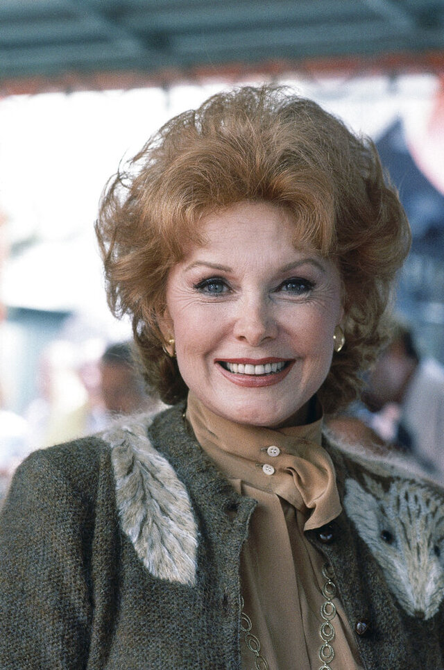 FILE - In this Sept. 28, 1981 file photo, Actress Rhonda Fleming poses for a photo in Hollywood, Calif. Actress Rhonda Fleming, the fiery redhead who appeared with Burt Lancaster, Kirk Douglas, Charlton Heston, Ronald Reagan and other film stars of the 1940s and 1950s, has died, Wednesday, Oct. 14, 2020. She was 97.(AP Photo/Wally Fong)
