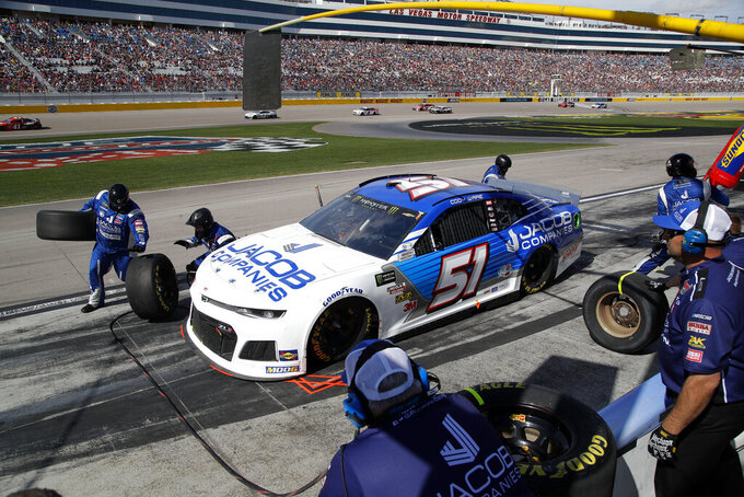 Cody Ware makes a pit stop during a NASCAR Cup Series auto race at the Las Vegas Motor Speedway, Sunday, March 3, 2019, in Las Vegas. (AP Photo/John Locher)