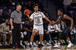 Georgia Tech guard Michael Devoe (0) passes the ball as Pittsburgh guard Xavier Johnson (1) defends during the second half of an NCAA college basketball game Wednesday, Feb. 20, 2019, in Atlanta. Georgia Tech won 73-65. (AP Photo/Danny Karnik)