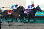 FILE - In this May 1, 2021, file photo, Medina Spirit, ridden by John Velazquez, right, leads Mandaloun, and jockey Florent Geroux, to the wire in the 147th running of the Kentucky Derby horse race at Churchill Downs in Louisville, Ky. Mandaloun is slated to run in the Haskell on Saturday, July 17, 2021, at Monmouth Park in Oceanport, N.J.   (AP Photo/Darron Cummings, File)