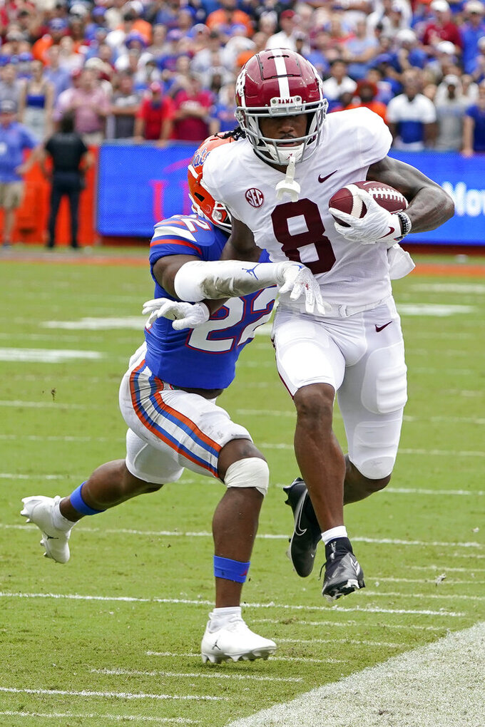 Alabama wide receiver John Metchie III (8) is forced out of bounds by Florida safety Rashad Torrence II, left, after a reception during the first half of an NCAA college football game, Saturday, Sept. 18, 2021, in Gainesville, Fla. (AP Photo/John Raoux)