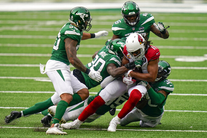 Arizona Cardinals wide receiver Larry Fitzgerald (11) is tackled by New York Jets free safety Marcus Maye (20) during the second half of an NFL football game, Sunday, Oct. 11, 2020, in East Rutherford. (AP Photo/Seth Wenig)