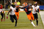Illinois running back Joshua McCray (0) stiff-arms Maryland linebacker Ruben Hyppolite II during the first half of an NCAA college football game Friday, Sept. 17, 2021, in Champaign, Ill. (AP Photo/Charles Rex Arbogast)
