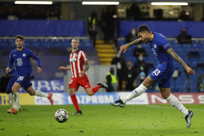 Chelsea's Emerson Palmieri, right, scores his side's second goal during the Champions League, round of 16, second leg soccer match between Chelsea and Atletico Madrid at the Stamford Bridge stadium, London, Wednesday, March 17, 2021. (AP Photo/Matt Dunham)