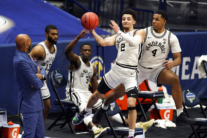 Vanderbilt's Scotty Pippen Jr. (2) keeps the ball from going out of bounds in the second half of an NCAA college basketball game against Texas A&M in the Southeastern Conference Tournament Wednesday, March 10, 2021, in Nashville, Tenn. (AP Photo/Mark Humphrey)