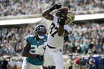 New Orleans Saints tight end Jared Cook (87) catches a pass for a 4-yard touchdown in front of Jacksonville Jaguars defensive back Jarrod Wilson, left, during the second half of an NFL football game, Sunday, Oct. 13, 2019, in Jacksonville, Fla. (AP Photo/Phelan M. Ebenhack)