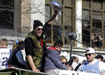 Tom Brady holds the trophy as the New England Patriots parade through downtown Boston, Tuesday, Feb. 5, 2019, to celebrate their win over the Los Angeles Rams in Sunday's NFL Super Bowl 53 football game in Atlanta. (AP Photo/Steven Senne)