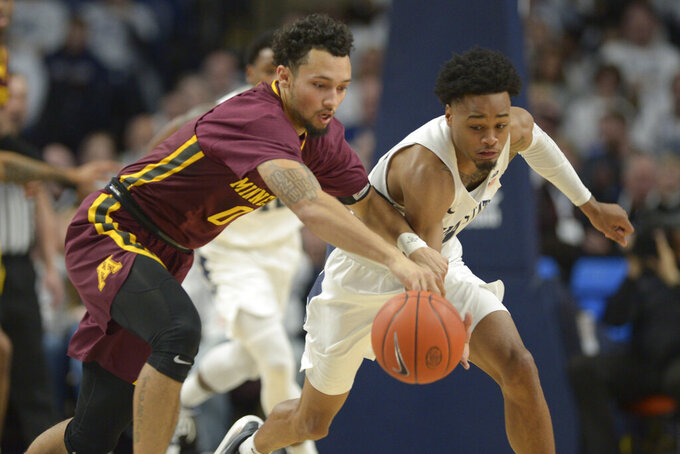 Minnesota's Payton Willis, left, and Penn State's Curtis Jones Jr. go after the ball during first-half action of an NCAA college basketball game, Saturday, Feb. 8, 2020, in State College, Pa. (AP Photo/Gary M. Baranec)