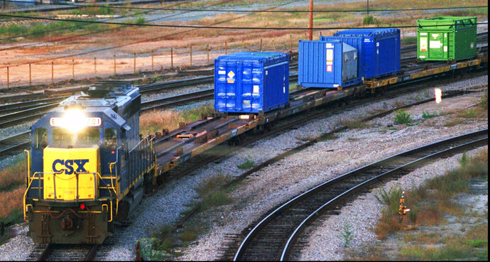 FILE - In this Sept. 29, 1994 file photo, a CSX Train with spent nuclear fuel passes through Florence, S.C., on its way to Savannah River Site Weapons Complex near Aiken S.C. Lawyers for Nevada and the Energy Department are accusing each other of contradicting their past arguments as the state seeks to restart a legal challenge to force the government to remove weapons-grade plutonium it secretly shipped to a site near Las Vegas last year. A federal judge in Reno refused earlier this year to issue a temporary injunction banning shipments of the radioactive material to Nevada after the government disclosed in January 2019, it already had trucked one-half metric ton of plutonium there. (Jeff Chatlosh/The Morning News via AP, File)
