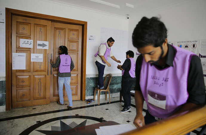 Maldivian polling workers prepare a polling station for expatriates at the Maldivian High Commission in Colombo, Sri Lanka, Saturday, April 6, 2019. Maldives President Ibrahim Mohamed Solih is hoping Saturday's parliamentary elections will help him overcome a coalition split that has hampered his efforts to restore political freedoms and tackle corruption. (AP Photo/Eranga Jayawardena)