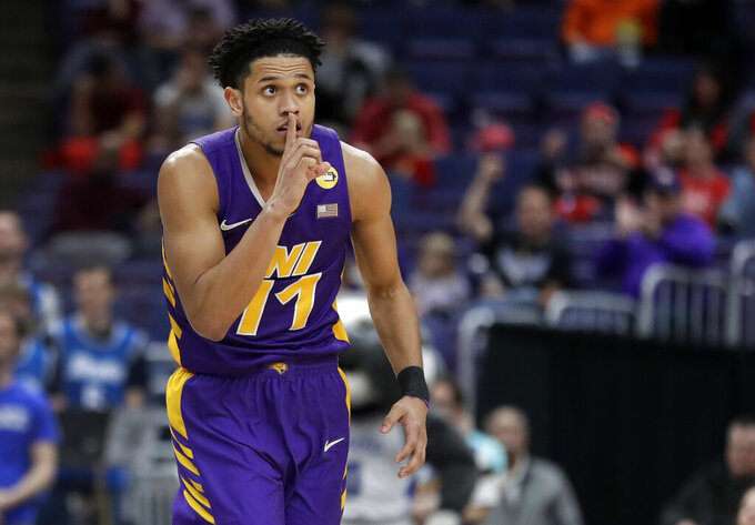 Northern Iowa's Trae Berhow gestures after making a 3-point basket during the first half of an NCAA college basketball game against Drake in the semifinal round of the Missouri Valley Conference tournament, Saturday, March 9, 2019, in St. Louis. (AP Photo/Jeff Roberson)