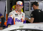 Denny Hamlin waits by his car before practice for Saturday's NASCAR All-Star Cup series auto race at Charlotte Motor Speedway in Concord, N.C., Friday, May 17, 2019. (AP Photo/Chuck Burton)