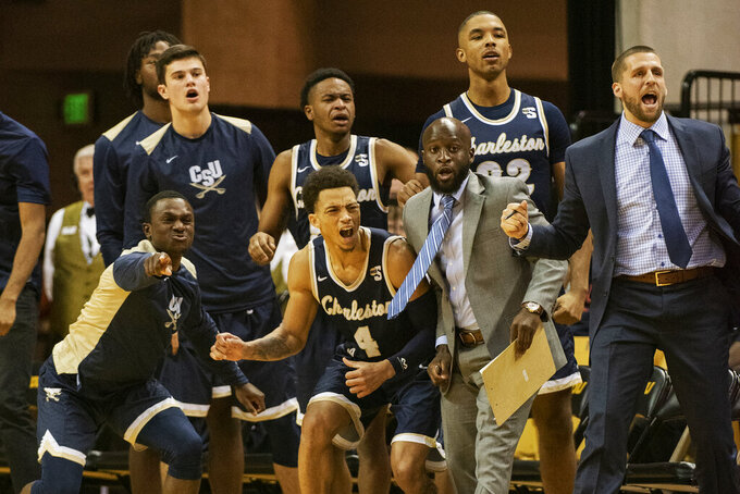 The Charleston Southern bench celebrates late during the second half of an NCAA college basketball game against Missouri Tuesday, Dec. 3, 2019, in Columbia, Mo. Charleston Southern won the game 68-60. (AP Photo/L.G. Patterson)