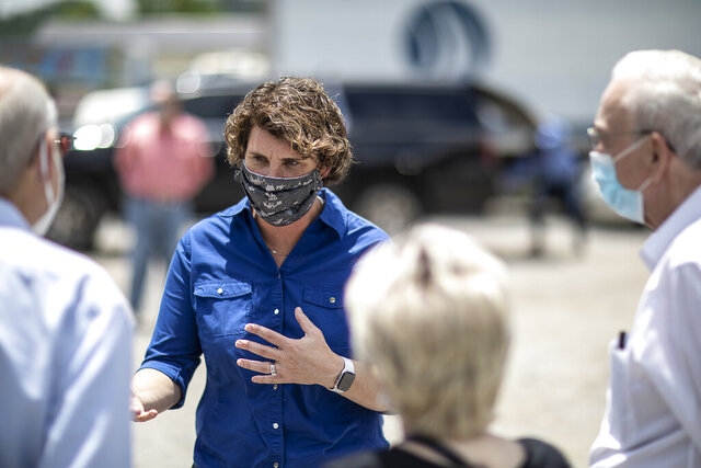 U.S. Senate candidate Amy McGrath speaks to people during a visit to Thankful Hearts Food Pantry in Pikeville, Ky., Monday, June 22, 2020. (Ryan C. Hermens/Lexington Herald-Leader via AP)