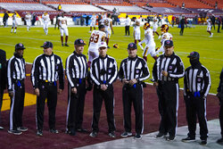 From l-r., Dale Shaw, Bart Longson, Derick Bowers, Steve Novak, Chad Hill, Bruce Stritesky and Terrence Miles pose for their Officials Portrait before the start of the first half of an NFL wild-card playoff football game between the Tampa Bay Buccaneers, and Washington Football team, Saturday, Jan. 9, 2021, in Landover, Md. (AP Photo/Julio Cortez)