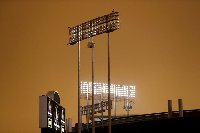 RingCentral Coliseum stands under skies darkened by wildfire smoke before the Oakland Athletics' baseball game against the Houston Astros in Oakland, Calif., Wednesday, Sept. 9, 2020. (AP Photo/Jed Jacobsohn)
