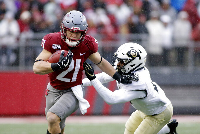 Washington State running back Max Borghi, left, runs while under pressure from Colorado safety Mikial Onu during the first half of an NCAA college football game in Pullman, Wash., Saturday, Oct. 19, 2019. (AP Photo/Young Kwak)
