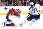 Washington Capitals goaltender Pheonix Copley (1) gets sprayed by St. Louis Blues center Jordan Nolan (71) during the first period of an NHL hockey game, Monday, Jan. 14, 2019, in Washington. (AP Photo/Nick Wass)