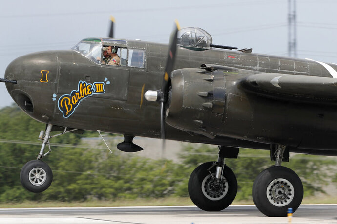 Vintage war aircrafts from the Cavanaugh Flight Museum take off from Addison Airport in Addison, Texas, Friday, May 22, 2020. The aircraft were scheduled to fly over several medical facilities and other locations in a tribute they call,