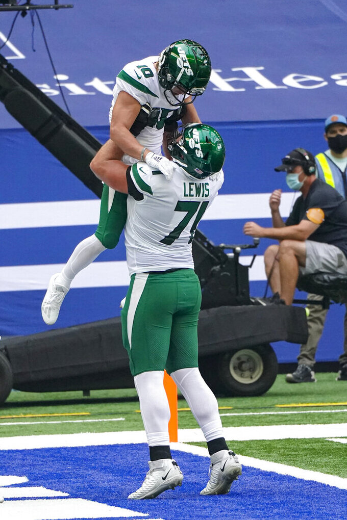 New York Jets wide receiver Braxton Berrios (10) celebrates a touchdown with offensive guard Alex Lewis (71) in the first half of an NFL football game against the Indianapolis Colts in Indianapolis, Sunday, Sept. 27, 2020. (AP Photo/AJ Mast)