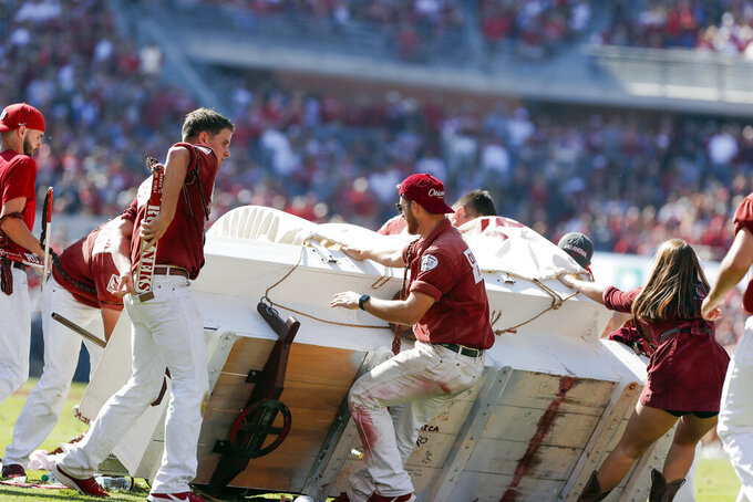 Oklahoma's Sooner Schooner tips over on field; no injuries