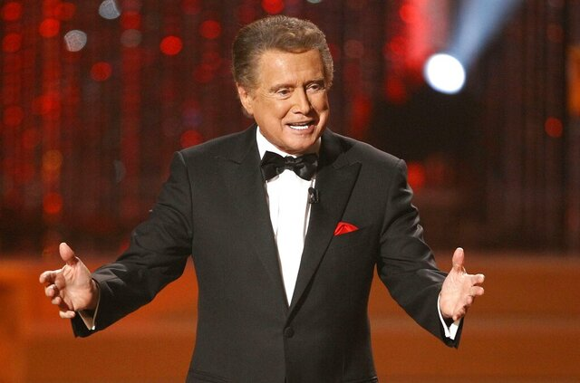 """FILE - In this June 27, 2010 file photo, host Regis Philbin is seen on stage at the 37th Annual Daytime Emmy Awards in Las Vegas.  Philbin, the genial host who shared his life with television viewers over morning coffee for decades and helped himself and some fans strike it rich with the game show """"Who Wants to Be a Millionaire,"""" has died on Friday, July 24, 2020.  (AP Photo/Eric Jamison)"""