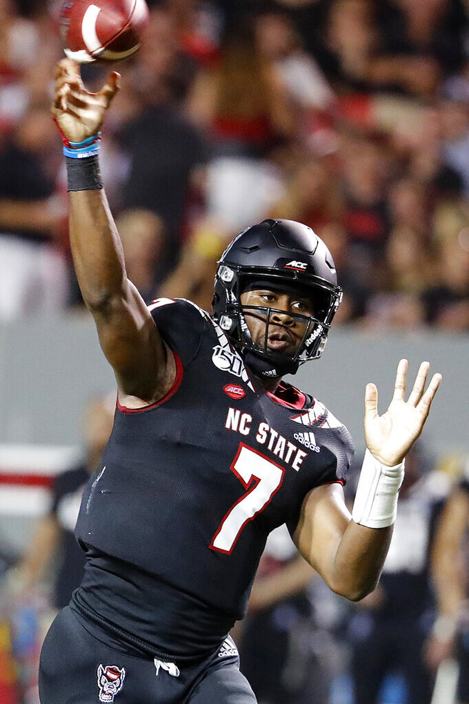 North Carolina State's Matthew McKay (7) throws the ball during the first half of an NCAA college football game against Ball State in Raleigh, N.C., Saturday, Sept. 21, 2019. (AP Photo/Karl B DeBlaker)