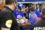 New York Giants' Daniel Jones (8) is carted off the field after suffering an unknown injury running the ball in the first half of an NFL football game against the Dallas Cowboys in Arlington, Texas, Sunday, Oct. 10, 2021. (AP Photo/Michael Ainsworth)