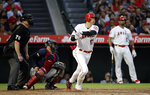 Los Angeles Angels' Shohei Ohtani follows through on a solo home run against the Cleveland Indians during the fifth inning of a baseball game Wednesday, Sept. 11, 2019, in Anaheim, Calif. (AP Photo/Marcio Jose Sanchez)