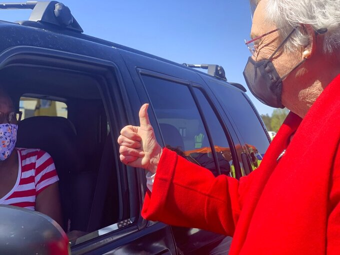 Alabama Gov. Kay Ivey gives a thumbs up to Doris Coleston after Coleston received a COVID-19 vaccination at a clinic in Camden, Ala. on Friday, April 2, 2021.  (AP Photo/Kim Chandler)