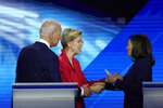 FILE - In this Sept. 12, 2019, file photo, from left, Democratic presidential candidate former Vice President Joe Biden, watches as then-candidates Sen. Elizabeth Warren, D-Mass., and Sen. Kamala Harris, D-Calif., shake hands  after a Democratic presidential primary debate hosted by ABC at Texas Southern University in Houston. Biden's search for a running mate is entering a second round of vetting for a dwindling list of potential vice presidential nominees, with several black women in strong contention. (AP Photo/David J. Phillip, File)