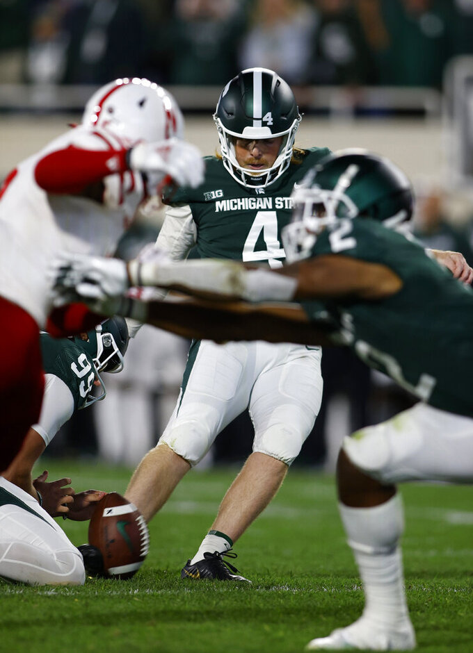 Michigan State's Matt Coghlin kicks the game-winning field goal against Nebraska during overtime of an NCAA college football game, Saturday, Sept. 25, 2021, in East Lansing, Mich. Michigan State won 23-20 in overtime. (AP Photo/Al Goldis)