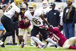 Florida State defensive back Raymond Woodie lll (31) tries to bring down Alabama State wide receiver Jahod Booker after a reception in the first half of an NCAA college football game in Tallahassee, Fla., Saturday, Nov. 16, 2019. (AP Photo/Mark Wallheiser)