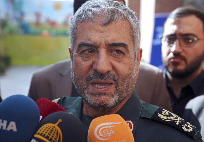 FILE - In this Oct. 31, 2017, file photo, the head of Iran's paramilitary Revolutionary Guard Gen. Mohammad Ali Jafari speaks to journalists after his speech at a conference called