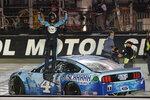 Kevin Harvick celebrates winning the NASCAR Cup Series auto race Saturday, Sept. 19, 2020, in Bristol, Tenn. (AP Photo/Steve Helber)