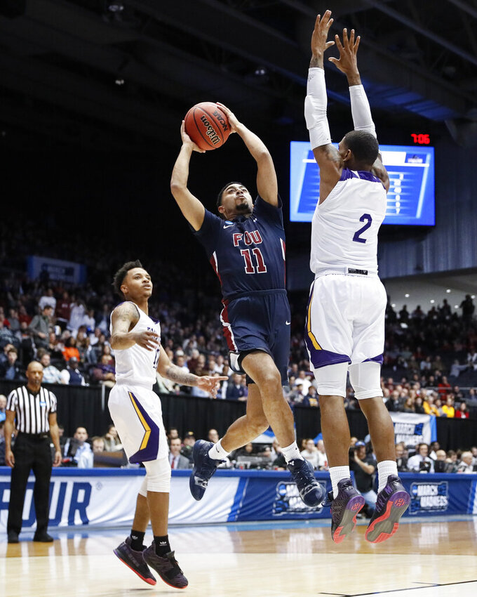 Fairleigh Dickinson's Tyler Jones (11) shoots against Prairie View A&M's Darius Williams (2) during the first half of a First Four game of the NCAA college basketball tournament, Tuesday, March 19, 2019, in Dayton, Ohio. (AP Photo/John Minchillo)