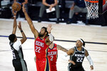 Sacramento Kings' De'Aaron Fox (5) shoots against New Orleans Pelicans' Derrick Favors (22) during the second half of an NBA basketball game Thursday, Aug. 6, 2020 in Lake Buena Vista, Fla. (AP Photo/Ashley Landis, Pool)
