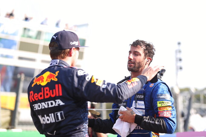Red Bull driver Max Verstappen of the Netherlands congratulates Mclaren driver Daniel Ricciardo of Australia after the Sprint qualifying at the Monza racetrack, in Monza, Italy , Saturday, Sept.11, 2021. The Formula one race will be held on Sunday. (Lars Baron/Pool photo via AP)