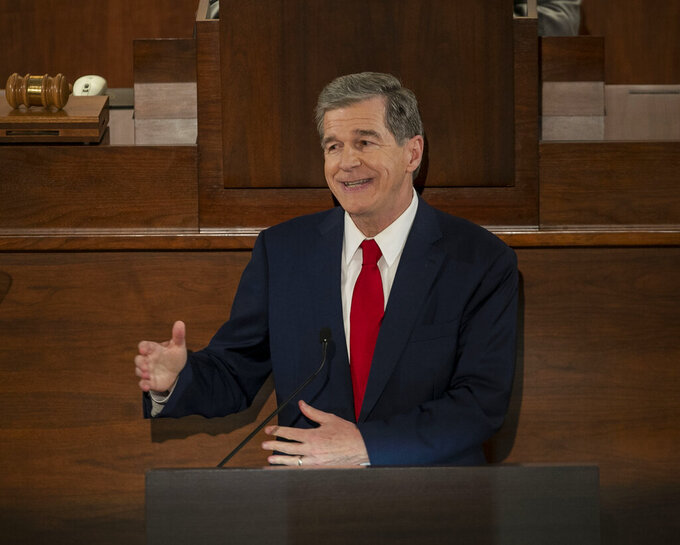 North Carolina Gov. Roy Cooper delivers his State of the State address before a joint session of the North Carolina House and Senate, Monday, April 26, 2021, in Raleigh, N.C. (Robert Willett/The News & Observer via AP)