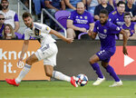 Orlando City's Ruan (2) moves the ball past LA Galaxy's Jorgen Skjelvik, left, during the first half of an MLS soccer match Friday, May 24, 2019, in Orlando, Fla. (AP Photo/John Raoux)