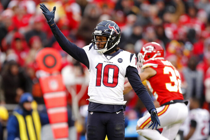 FILE - In this Jan. 12, 2020, file photo, Houston Texans wide receiver DeAndre Hopkins (10) motions a first down during the first half of an NFL divisional playoff football game against the Kansas City Chiefs in Kansas City, Mo.  The head-scratching decisions could significantly shape the NFL's only division with two playoffs teams in each of the last three years. Jacksonville dumped five potential starters, including three former Pro Bowlers. Houston traded away perennial All-Pro receiver DeAndre Hopkins. (AP Photo/Jeff Roberson, File)