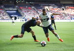 San Jose Earthquakes' Magnus Eriksson, left, and Vancouver Whitecaps' Ali Adnan vie for the ball during the first half of an MLS soccer game, Saturday, July 20, 2019 in Vancouver, British Columbia. (Darryl Dyck/The Canadian Press via AP)