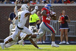 CORRECTS TO SECOND HALF - Mississippi running back Scottie Phillips (22) runs past Southeastern Louisiana defensive backs Dejion Lynch (6) and Donniel Ward-Magee (8) for a 27-yard touchdown during the second half of an NCAA college football game in Oxford, Miss., Saturday, Sept. 14, 2019. Mississippi won 40-29. (AP Photo/Thomas Graning)